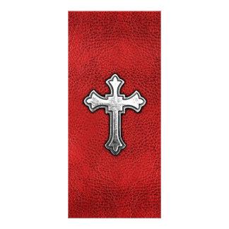 Cruz del metal en el cuero rojo lona publicitaria