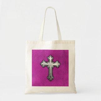 Cruz del metal en el cuero rosado bolsa