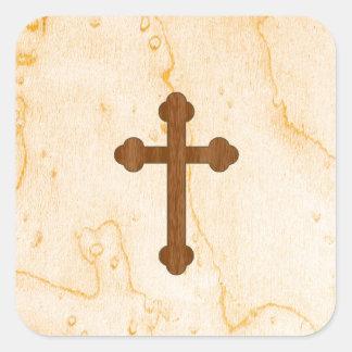 Cruz en mirada de madera ligera y oscura pegatina cuadrada