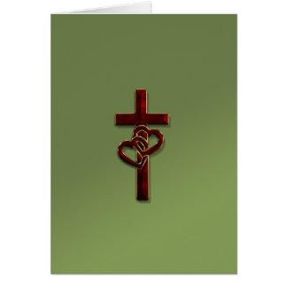 Cruz entrelazada de los corazones tarjeta de felicitación