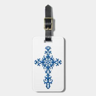 Cruz gótica de acero azul en blanco etiquetas maleta