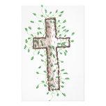 Cruz hermosa con las hojas de la hiedra papeleria