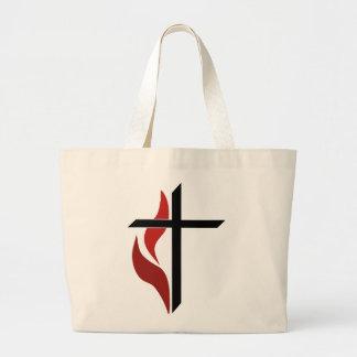 Cruz llameante bolsas lienzo