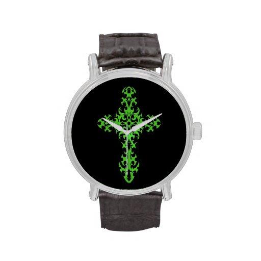 Cruz verde compleja en negro reloj de mano