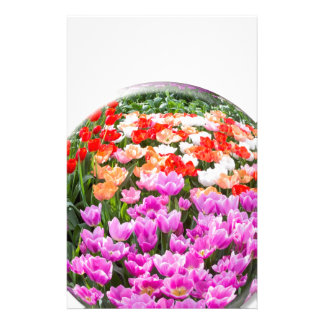 Crystal ball with various colored tulips on white stationery
