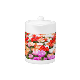Crystal ball with various colored tulips on white teapot