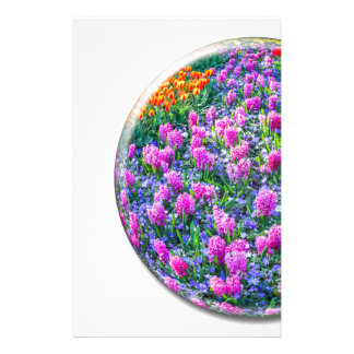 Crystal sphere with pink hyacinths on white stationery