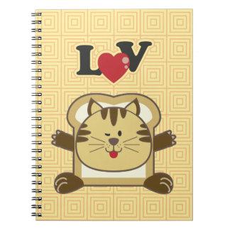 Cuaderno amarillo del gato que empana