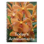 Cuaderno anaranjado de la orquídea