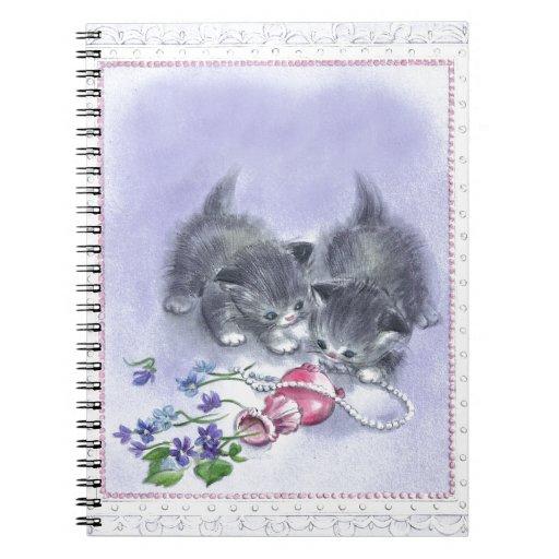 Cuaderno antiguo de las perlas de los gatitos del