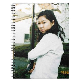 Cuaderno asiático de la foto de la acción de la mu