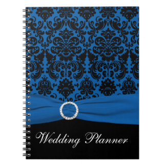 Cuaderno azul y negro del planificador del boda de