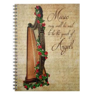 Cuaderno color de rosa irlandés de la arpa