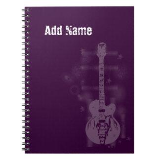 Cuaderno de encargo púrpura gráfico de la guitarra