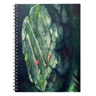 Cuaderno de la foto de la espada y de la flauta