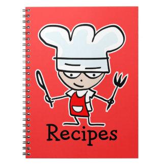 Cuaderno de la receta con el cocinero lindo del co