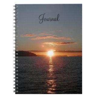 Cuaderno de la salida del sol del océano