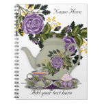 Cuaderno de notas con té, magdalenas y rosas