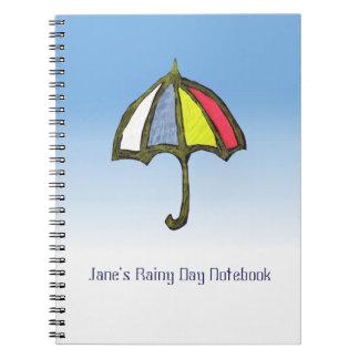 Cuaderno del paraguas de la actividad del día lluv