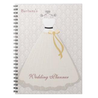 Cuaderno del planificador del boda de la silueta d