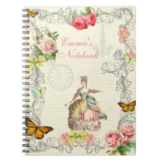 Cuaderno del vintage con los rosas y las mariposas