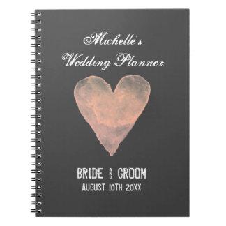 Cuaderno gris y rosado del organizador del