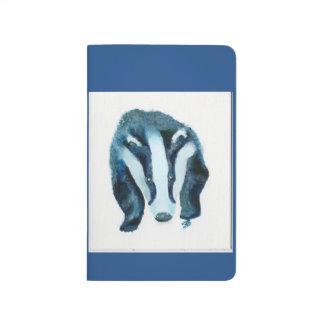 Cuaderno hermoso con el tejón en sombras del azul