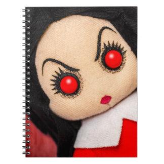 Cuaderno malvado de la mirada de la muñeca de trap
