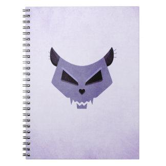 Cuaderno púrpura estilizado malvado del cráneo del