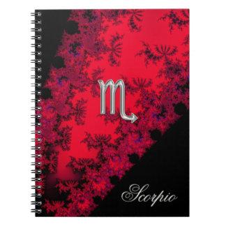 Cuaderno rojo y negro del escorpión de la muestra