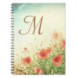 Cuaderno rosado de la inicial del monograma de las