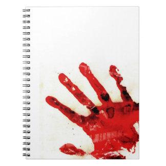Cuaderno sangriento de la mano