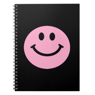 cuaderno sonriente rosado de la cara