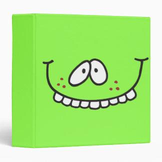 cuaderno verde sonriente de los dientes divertidos