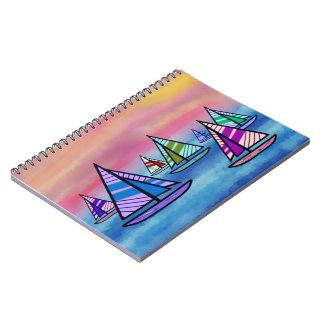 Cuadernos espirales de la salida del sol del veler