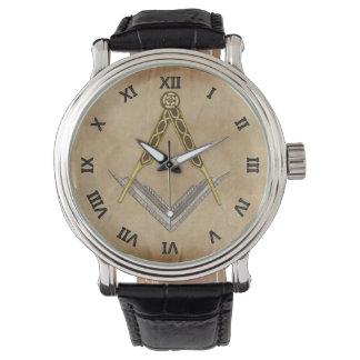 Cuadrado y compás con todo el ojo que ve relojes de pulsera