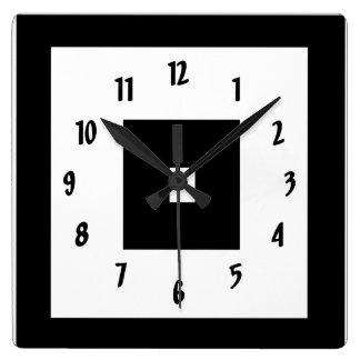Cuadrados blancos y negros reloj de pared