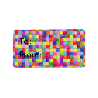 Cuadrados coloreados del papel cuadriculado a y etiqueta de dirección