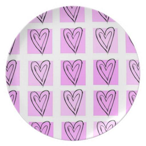 Cuadrados del corazón del rosa en colores pastel platos de comidas