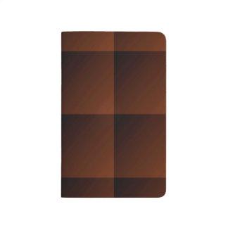 Cuadrados pelirrojos de la mirada del control de cuaderno grapado