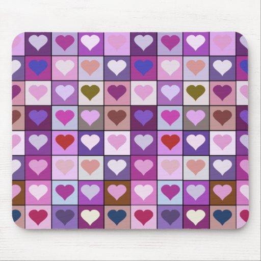 Cuadrados púrpuras y rosados del corazón tapetes de ratón