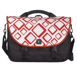 Cuadrados rojos retros en el bolso blanco del orde bolsas de ordenador