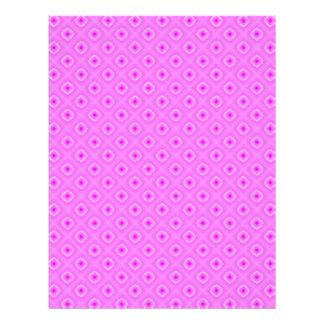 Cuadrados rosados en las páginas del papel del membrete a diseño