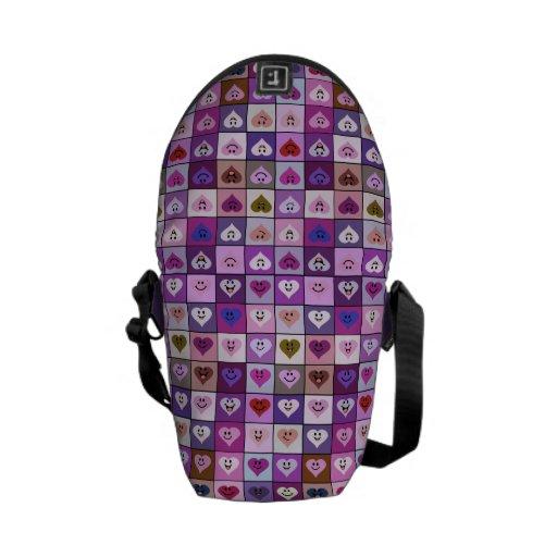 Cuadrados sonrientes rosados y púrpuras del corazó bolsas messenger