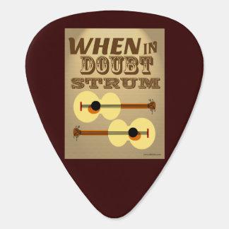 Cuando en rasgueo de la duda púa de guitarra