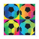 Cuatro balones de fútbol en diversos colores impresiones en lona estiradas