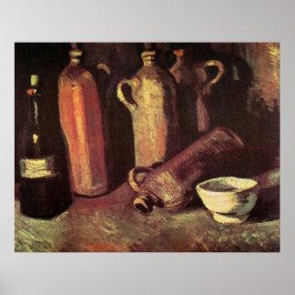 Cuatro botellas de piedra, frasco y taza blanca -  impresiones