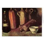 Cuatro botellas de piedra, frasco y taza blanca -  felicitaciones