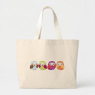 Cuatro búhos coloridos bolsas de mano