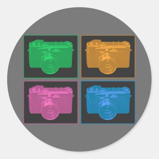 Cuatro cámaras retras coloridas etiqueta redonda